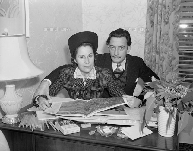 Mr. and Mrs. Salvador Dali Examining a Book Together
