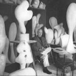 jean-arp-in-his-studio-with-sculpture